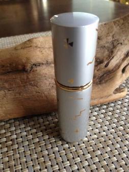 A travel size purse atomizer refillable fragrance Or Hand Sa