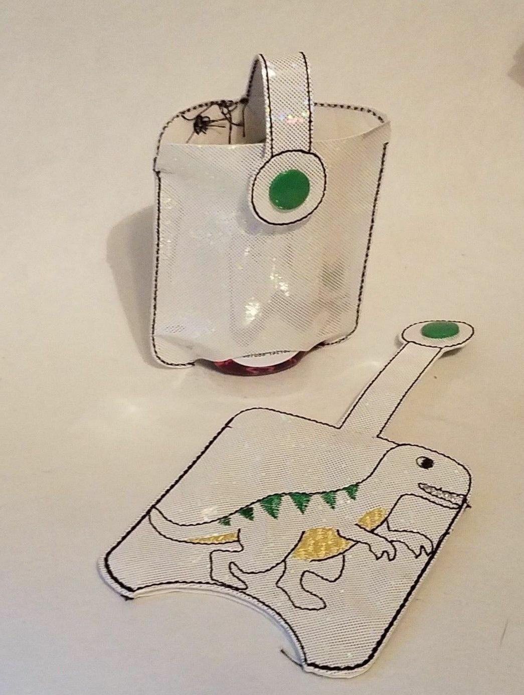 Hand Holder White Sparkle Dinosaur Embroidered 1 oz Works