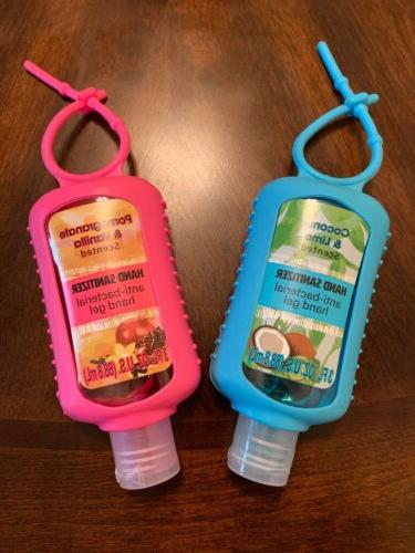 Lot Two Scented Hand Sanitizers With Silicone Warp Holder 3 OZ.